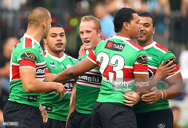 Jason Clarke of Rabbitohs celebrates with his team mates after scoring a try during the NRL trial match between South Sydney Rabbitohs and Manly Sea...