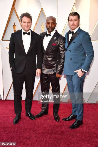 Jason Clarke Rob Morgan and Garrett Hedlund attend the 90th Annual Academy Awards at Hollywood Highland Center on March 4 2018 in Hollywood California
