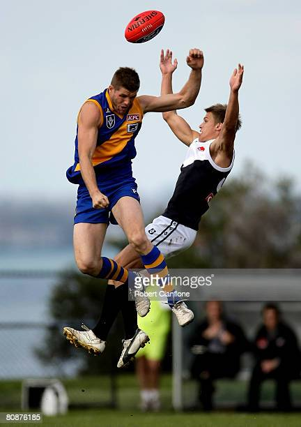 Jason Cloke of Williamstown spoils the ball for his opponent during the round five VFL match between Williamstown and North Ballarat at Burbank Oval...