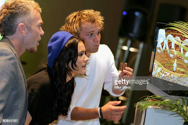 Jason Coleman Natalie Blair Lincoln Lewis playing XBox at the 'Stuff That Rocks' Gift Villa at the Hilton Hotel on April 24 2008 in Sydney Australia
