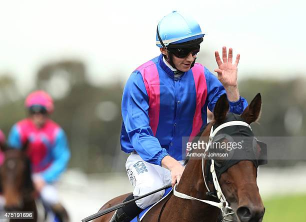 Jason Collett returns on Missvonn after winning race 2 The Hyland Race Colours Handicap during Sydney Racing at Rosehill Gardens on May 30 2015 in...