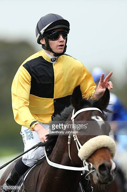 Jason Collett returns on You'll Never after winning race 5 The Octagonal Handicap during Sydney Racing at Rosehill Gardens on May 30 2015 in Sydney...