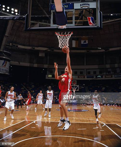 Jason Collier of the Atlanta Hawks shoots a layup during the preseason game against the Charlotte Bobcats at Crown Coliseum on October 27, 2004 in...
