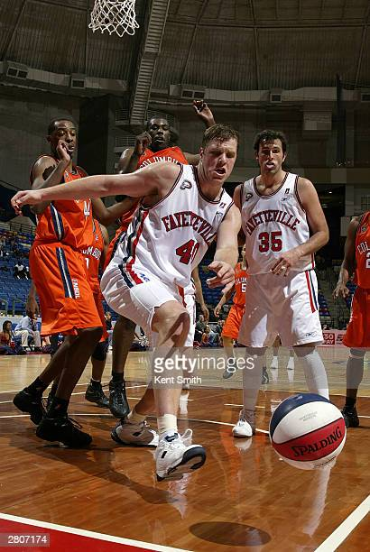 Jason Collier of the Fayetteville Patriots goes for the loose ball the Columbus Riverdragons December 12, 2003 at the Crown Coliseum in Fayetteville,...