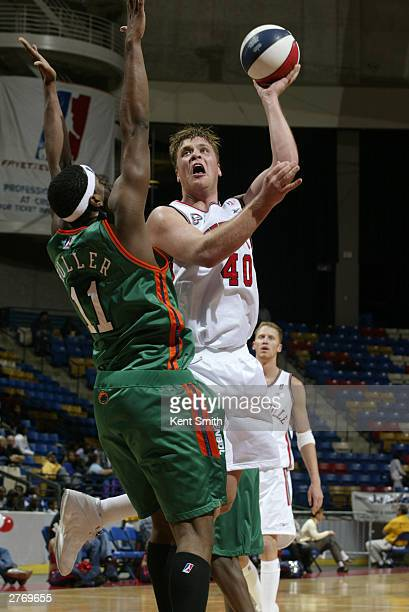 Jason Collier of the Fayetteville Patriots makes the baby hook shot in middle against Hiram Fuller of the Charleston Lowgators at the Crown Coliseum...