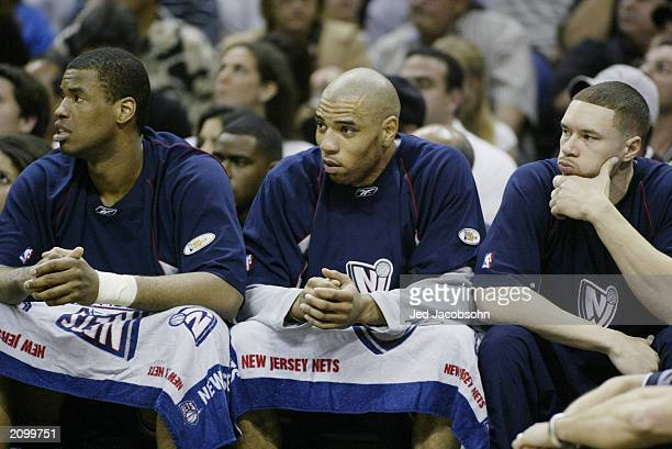 Jason Collins Kenyon Martin and Aaron Williams of the New Jersey Nets look on from the bench in Game six of the 2003 NBA Finals against the San...