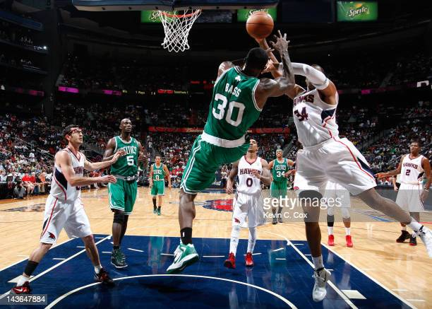 Jason Collins of the Atlanta Hawks fouls Brandon Bass of the Boston Celtics in Game Two of the Eastern Conference Quarterfinals in the 2012 NBA...
