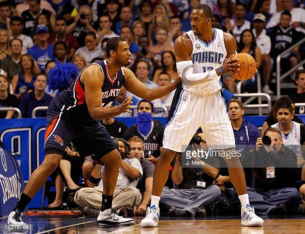 Jason Collins of the Atlanta Hawks guards Dwight Howard of the Orlando Magic during Game Five of the Eastern Conference Quarterfinals of the 2011 NBA...