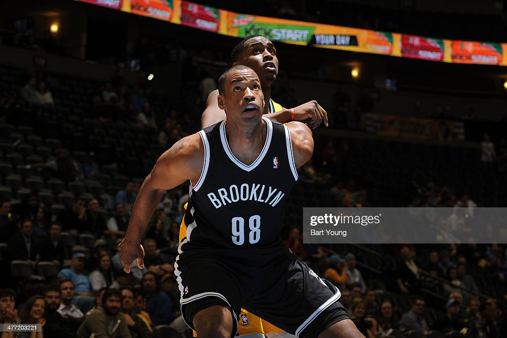 Jason Collins #98 of the Brooklyn Nets boxes out during a game against the Denver Nuggets on February 27, 2014 at the Pepsi Center in Denver, Colorado.