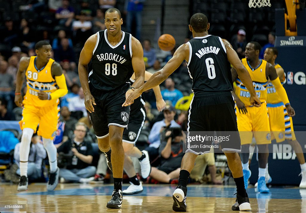 Jason Collins #98 of the Brooklyn Nets celebrates after making a basket with teammate Alan Anderson #6 during a game against the Denver Nuggets at Pepsi Center on February 27, 2014 in Denver, Colorado. Collins is the first openly gay athlete to play in one of the four major sports in the United States. Collins will wear #98 in honor of Matthew Shepard who was killed as part of a hate crime in 1998 near Laramie, Wyoming. Shepard's parents are expected to be in the crowd tonight.
