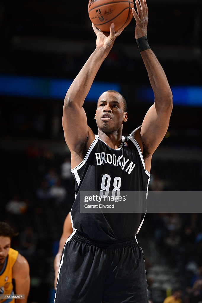 Jason Collins #98 of the Brooklyn Nets takes a free throw during a game against the Denver Nuggets on February 27, 2014 at the Pepsi Center in Denver, Colorado.