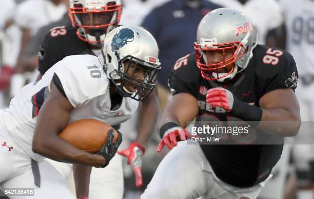 Jason Collins of the Howard Bison runs against defensive lineman Jason Fao of the UNLV Rebels during their game at Sam Boyd Stadium on September 2...