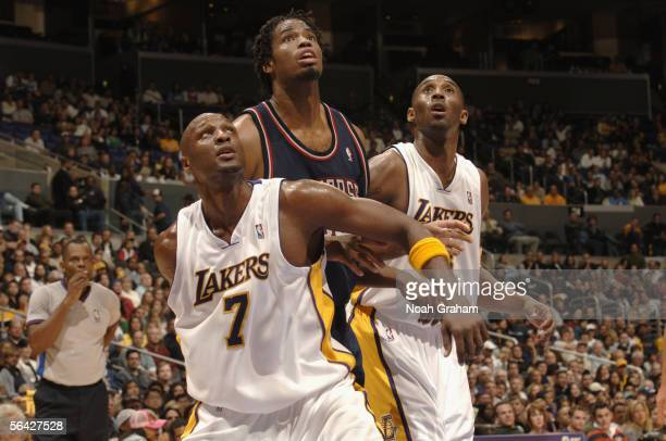 Jason Collins of the New Jersey Nets battles for position under the basket with Lamar Odom and Kobe Bryant of the Los Angeles Lakers during the game...