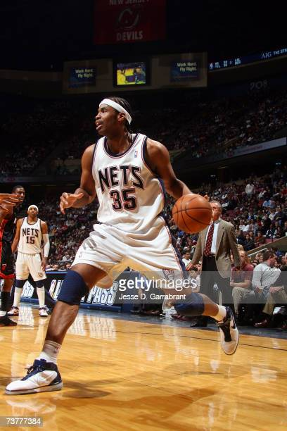 Jason Collins of the New Jersey Nets controls the ball during the game against the Miami Heat at Continental Airlines Arena on March 15 2007 in East...