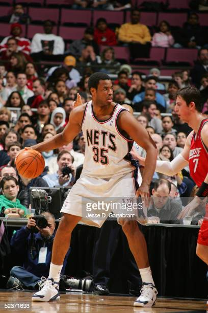 Jason Collins of the New Jersey Nets moves the ball against Primoz Brezec of the Charlotte Bobcats during the game on February 25 2005 at the...