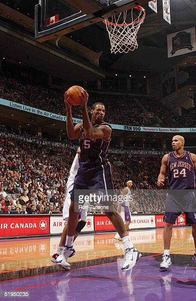 Jason Collins of the New Jersey Nets rebounds against the Toronto Raptors during the game at Air Canada Centre on December 19 2004 in Toronto Canada...