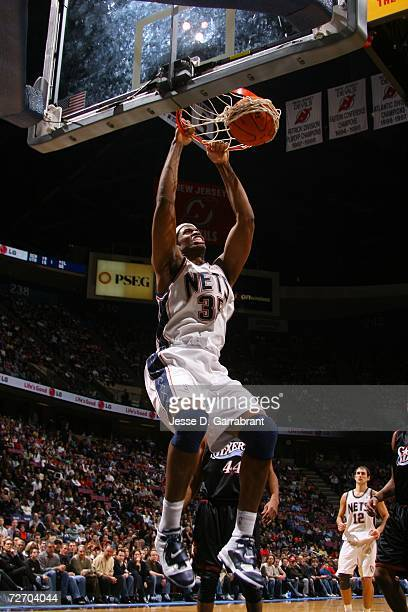 Jason Collins of the New Jersey Nets shoots against the Philadelphia 76ers on December 2 2006 at the Continental Airlines Arena in East Rutherford...