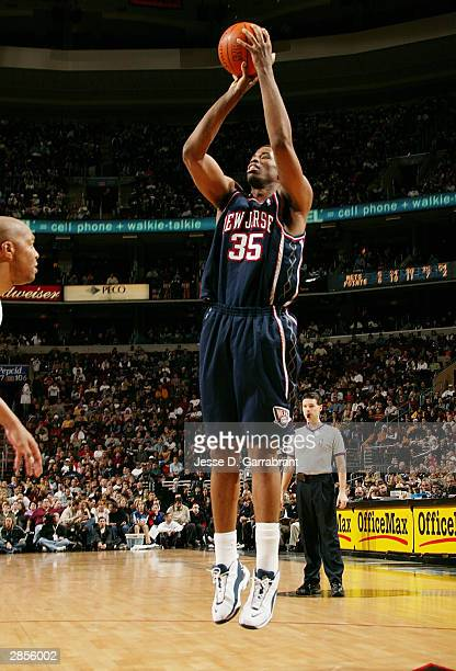 Jason Collins of the New Jersey Nets takes a jumper against Derrick Coleman of the Philadelphia 76ers January 9, 2004 at the Wachovia Center in...