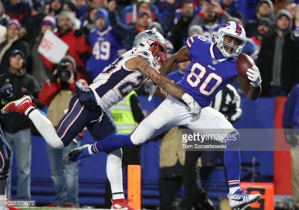 Jason Croom of the Buffalo Bills cannot hold on to the ball as he drops a touchdown pass in the end zone during NFL game action against the New...