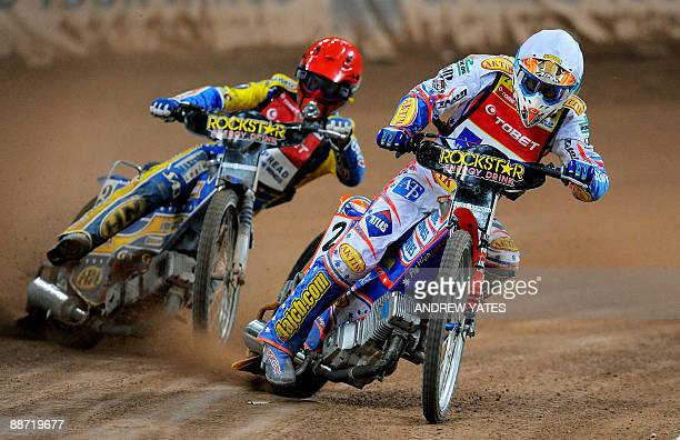 Jason Crump of Australia leads Tomasz Gollob of Poland during the British speedway grand prix at the Millennium stadium in Cardiff on June 27 2009...