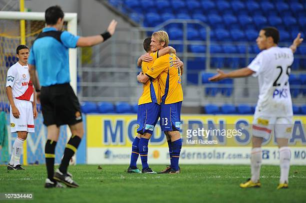 Jason Culina and Sebastiaan Van Den Brink of the Gold Coast celebrate a goal during the round 17 ALeague match between Gold Coast United and the...
