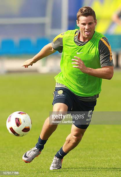 Jason Culina of Australia chases the ball during an Australian Socceroos training session ahead of the AFC Asian Cup at Al Wakrah Stadium on January...