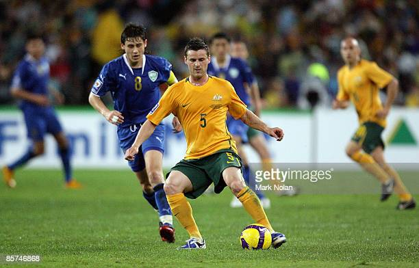 Jason Culina of Australia controls the ball during the 2010 FIFA World Cup qualifying match between the Australian Socceroos and Uzbekistan at ANZ...