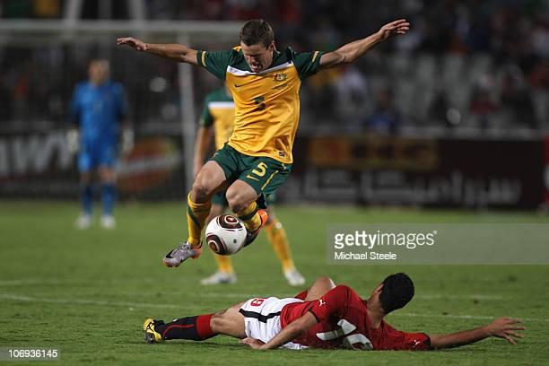 Jason Culina of Australia leaps above the challenge of Ahmed Samir Farag of Egypt during the Egypt v Australia International Friendly match at the...