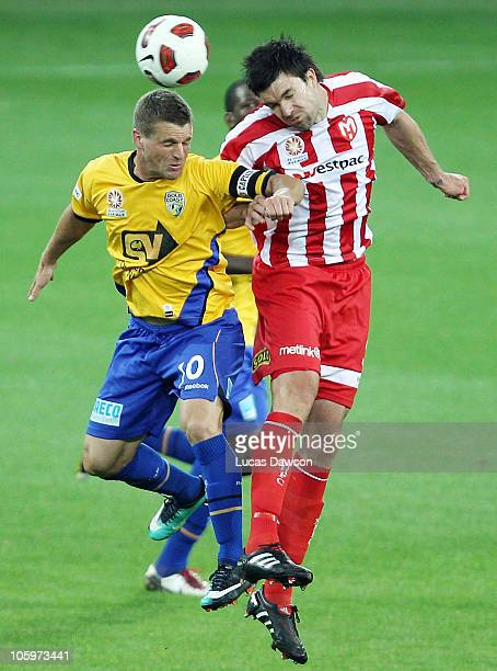 Jason Culina of Gold Coast competes with Michael Beauchamp of the Heart for the ball during the ALeague match between the Melbourne Heart and Gold...