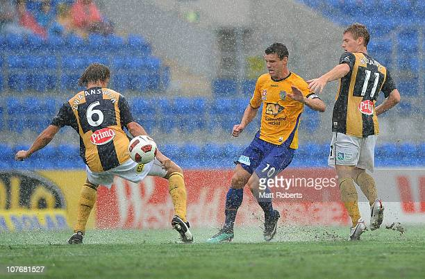 Jason Culina of Gold Coast passes the ball during the round 19 ALeague match between Gold Coast United and the Central Coast Mariners at Skilled Park...