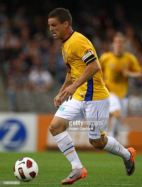 Jason Culina of Gold Coast United runs with the ball during the round 13 ALeague match between the Melbourne Victory and Gold Coast United at Etihad...
