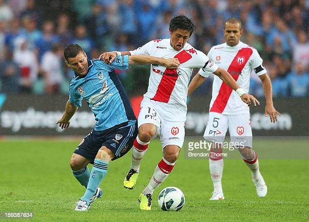 Jason Culina of Sydney competes with Jonathan Germano of the Heart during the round 16 ALeague match between Sydney FC and the Melbourne Heart at...