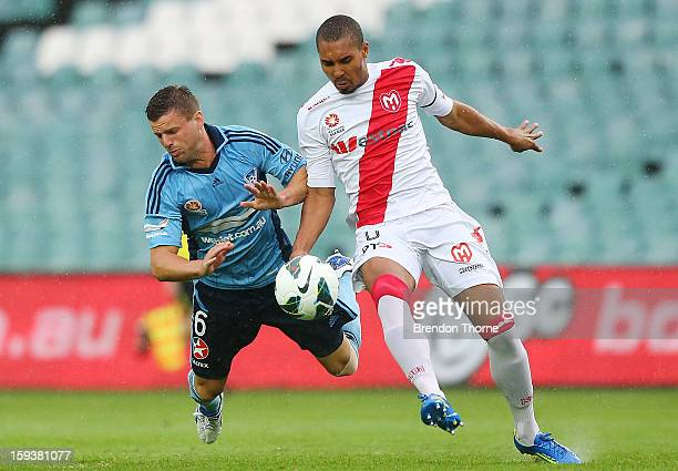 Jason Culina of Sydney competes with Patrick Gerhardt of the Heart during the round 16 ALeague match between Sydney FC and the Melbourne Heart at...