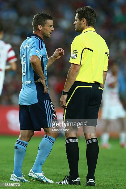 Jason Culina of Sydney FC speaks to the referee Chris Beath during the round 11 ALeague match between Sydney FC and the Western Sydney Wanderers at...