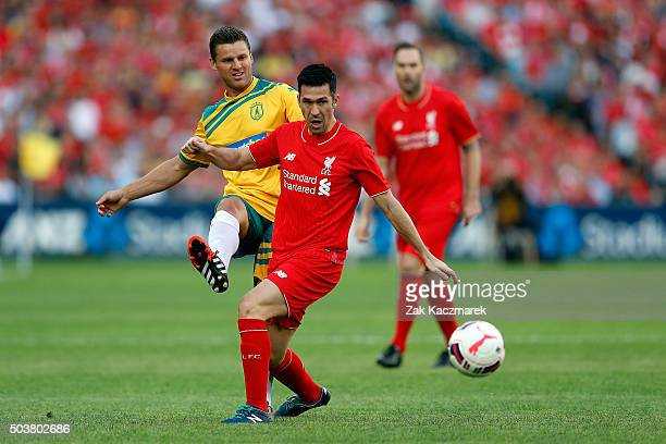 Jason Culina of the Australian Legends competes with Luis Garcia of the Liverpool Legends during the match between Liverpool FC Legends and the...