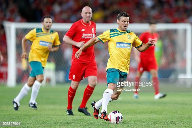 Jason Culina of the Australian Legends evades Gary McAllister of Liverpool FC Legends during the match between Liverpool FC Legends and the...