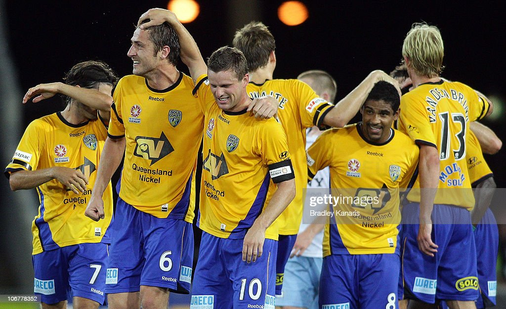 Jason Culina of the Gold Coast celebrates with team mates after scoring a goal during the round 14 A-League match between Gold Coast United and Sydney FC at Skilled Park on November 12, 2010 in Gold Coast, Australia.
