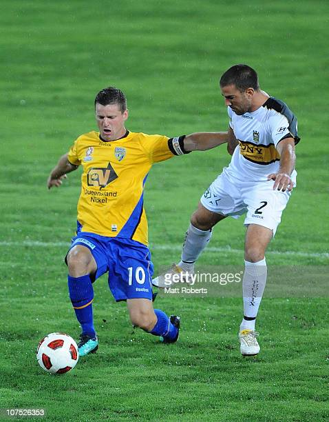 Jason Culina of the Gold Coast competes for the ball with Emmanuel Muscat of the Phoenix during the round 18 ALeague match between Gold Coast United...