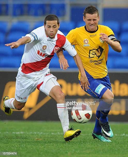 Jason Culina of the Gold Coast contests the ball with Adrian Zahra of the Heart during the round 17 ALeague match between Gold Coast United and the...