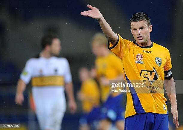 Jason Culina of the Gold Coast signals to his players with a hand gesture during the round 18 ALeague match between Gold Coast United and the...