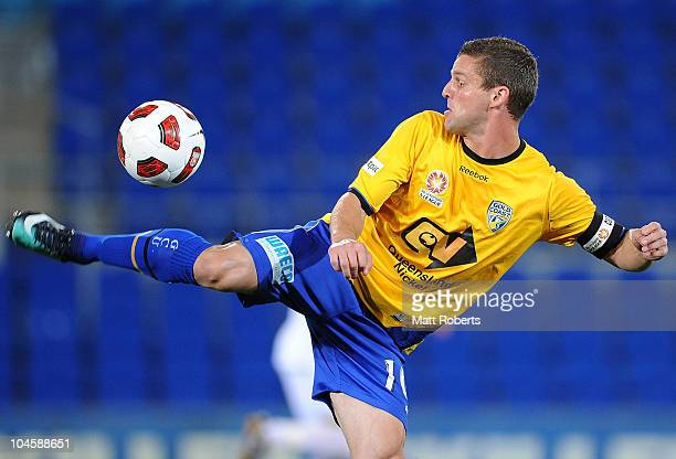 Jason Culina of the Gold Coast stickes the ball during the round nine ALeague match between Gold Coast United and the Wellington Phoenix at Skilled...
