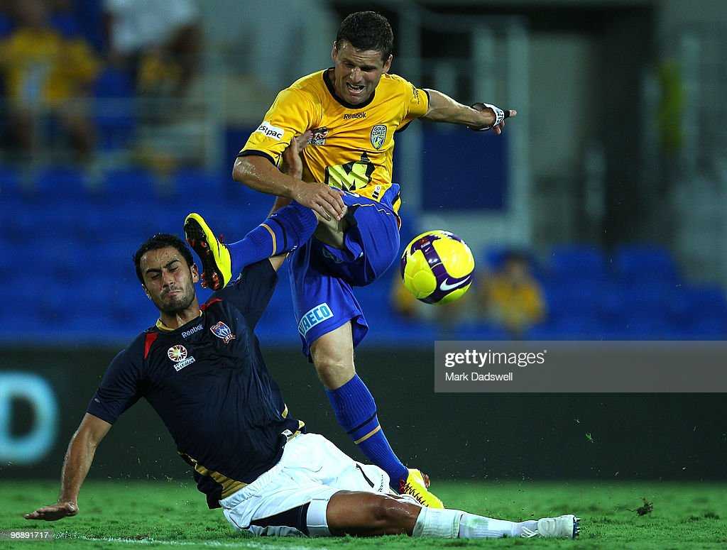 Jason Culina of United has a shot at goal over Tarek Elrich of the Jets during the A-League semi final match between Gold Coast United and the Newcastle Jets at Skilled Park on February 20, 2010 on the Gold Coast, Australia.