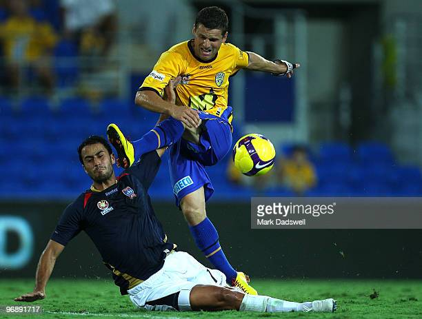 Jason Culina of United has a shot at goal over Tarek Elrich of the Jets during the ALeague semi final match between Gold Coast United and the...