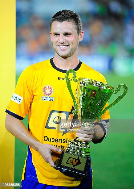 Jason Culina poses with the Queensland Nickel Cup after winning the round 12 ALeague match between the North Queensland Fury and Gold Coast United at...