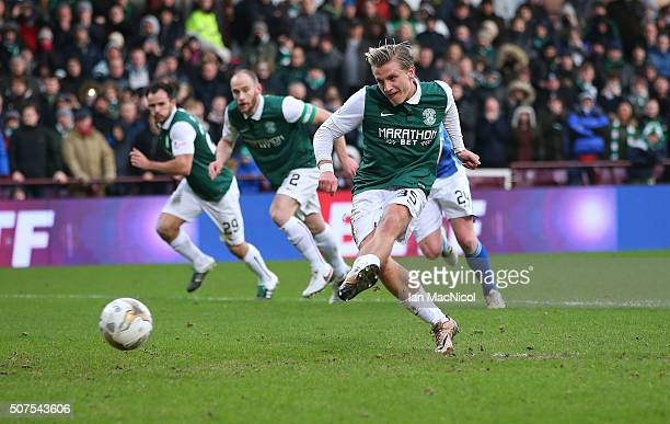 Jason Cummings of Hibernaian scores a penalty during the Scottish League Cup Semi final match between Hibernian and St Johnstone at Tynecastle...