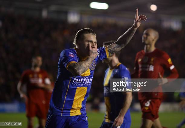 Jason Cummings of Shrewsbury celebrates scoring the first goal from the penalty spot during the FA Cup Fourth Round match between Shrewsbury Town and...