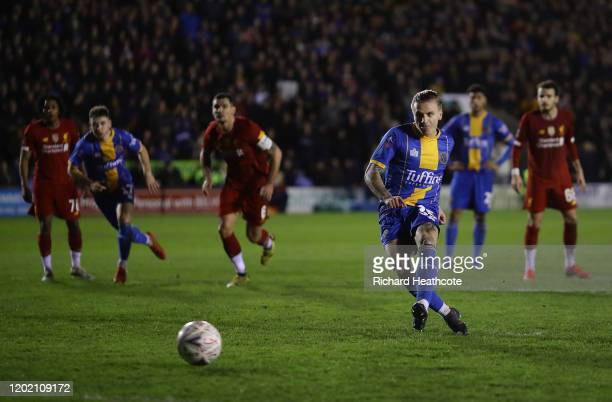 Jason Cummings of Shrewsbury scores the first goal from the penalty spot during the FA Cup Fourth Round match between Shrewsbury Town and Liverpool...