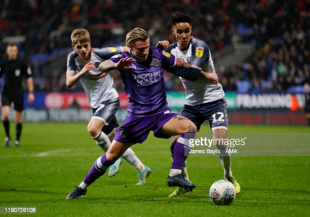 Jason Cummings of Shrewsbury Town and Adam Chicksen of Bolton Wanderers during the Sky Bet League One match between Bolton Wanderers and Shrewsbury...