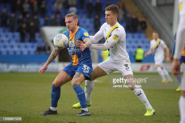 Jason Cummings of Shrewsbury Town and Josh Ruffles of Oxford United during the Sky Bet League One match between Shrewsbury Town and Oxford United at...