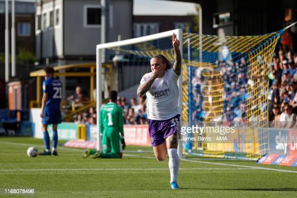 Jason Cummings of Shrewsbury Town celebrates after scoring a goal to make it 11 during the Sky Bet League One match between AFC Wimbledon and...